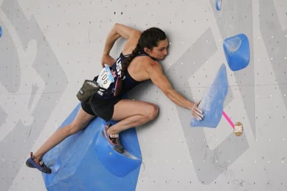 United States' Kyra Condie climbs during women's boulder qualification at the climbing World Cup on May 21, 2021, in Salt Lake City. Kyra Condie was told she needed back surgery to fix a severe curvature in her spine and would never be able to climb again. She did have surgery, after getting a second opinion, and has willed herself into becoming one of the world's elite climbers despite having 10 vertebrae fused together. (AP Photo/Rick Bowmer, File)